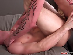 Brandon Evans gets Cage Kafig undressed after a few kisses, and when Brandon takes his own pants off Cage is on that cock, mouthing that dick through Brandon�s boxers before taking them off and sucking that dick.  Cage cups Brandon�s balls as he licks tha