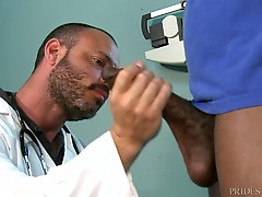 Dr. Doves is quite impressed with the size and has Corey lie back on the table as he starts sucking it. He then tells Corey that he should fuck him to see how he does at fucking and he lies on the exam table and has Corey slowly start fucking him with his