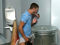 Mike pushes his cock through the hole and Austin slowly gets down on his knees and begins to suck the dick.