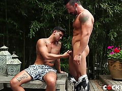 Ricky`s rock hard cock is straining against his tight belly when Jimmy reaches down to grab that dick.