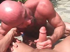 Cute guy gets his stiff dick sucked by experienced hairy man.