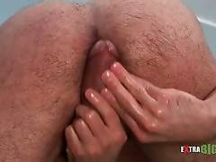 Dude stimulates his starving asshole with his own large cock.